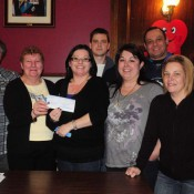 Far left – Angela Hourie (executive) Betty Roe (president) Kora-Lee Thornsteinson receiving the cheque and family members in attendance.